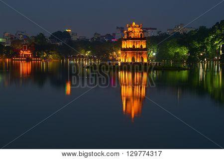 HANOI, VIETNAM - DECEMBER 13, 2015: Panorama of lake of the Returned Sword in the twilight. The historical center of Hanoi. Historical landmark of the city Hanoi, Vietnam