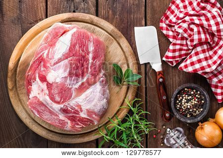 raw meat on wooden board on table, top view
