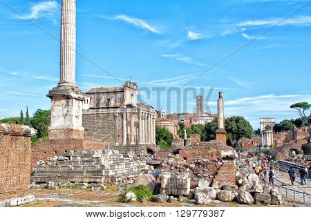 ROMEITALY- September 17 2010: Tourists visit the Imperial Fora a series of monumental fora (public squares) constructed in ancient Rome.