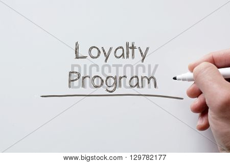 Human hand writing loyalty program on whiteboard
