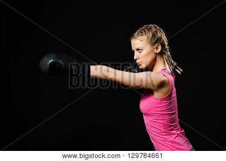 Beautiful determined woman is having boxing training.