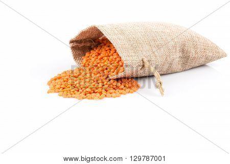 Red Lentils In Burlap Bag