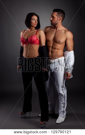 Striptease show. Image of sexy couple posing in studio