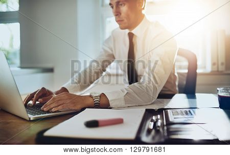 Business Man Working On A Laptop