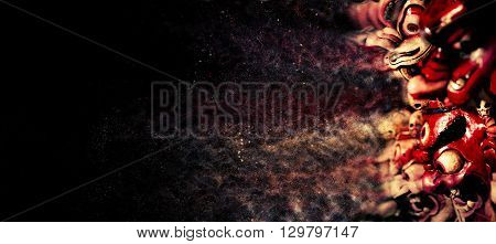 Photo of red and white indian or japanese demons. Dispersion special effect and black background