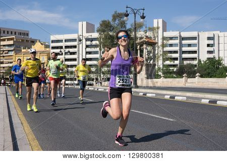 VALENCIA, SPAIN - MAY 15, 2016: Runners competing in the Volta a Peu Valencia Caixa Popular 8k run. Over 15,000 runners participated in this event.