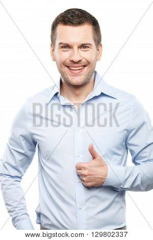 Everything is okay. Portrait of attractive young guy showing ok sign. He is smiling with happiness. Isolated