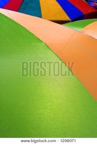 umbrellas at the beach combine for a colorful abstract poster
