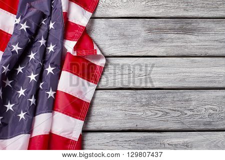 Creased flag of US. National flag on wooden background. Democracy drives the progress. Have faith in brighter future.