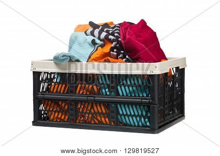 Plastic box with clothing donations over white background