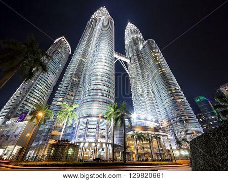 Kuala Lumpur, Malaysia - April 18, 2014: View of famous Petronas Towers lit up at night in Kuala Lumpur, Malaysia.