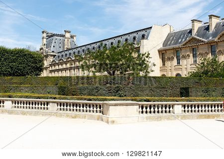 Parisian architecture with formal gardens and park