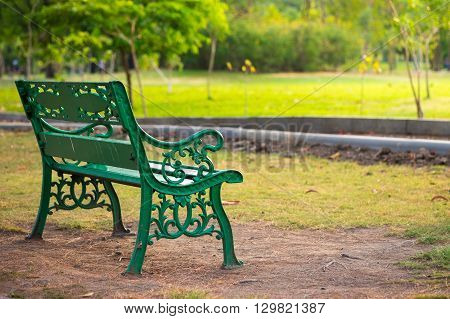 Bench in a park, Park Bench, conceptual of weekend and relaxation.