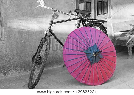 Retro bicycle with red umbrella Color in black and white conceptual idea. Vintage retro style