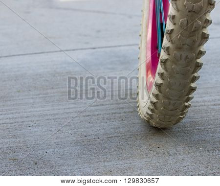 Tire from a girls bike when she is being active
