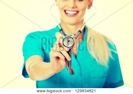 Smile female doctor or nurse uses stethoscope