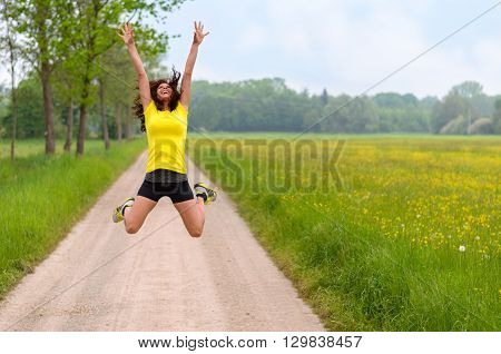 Energetic Agile Young Woman Leaping For Joy