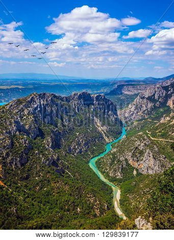 The largest alpine canyon Verdon spring. Canyon of Verdon, Provence, France. Emerald  river is flowing at the bottom of gorge