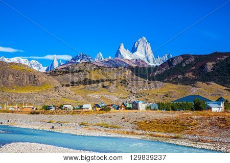 Amazing Patagonia in February. The white top of Fitzroy rocks covered the midday sun. The drying-up river in the valley of town of El Chalten