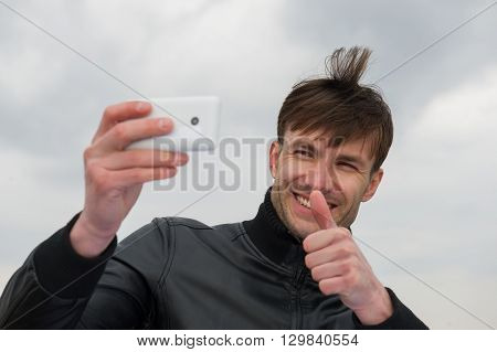 businessman doing selfie smartphone outdoors age 35 years