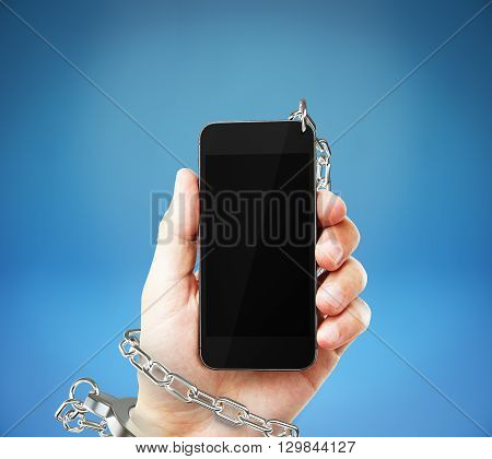 Smartphone with blank screen cuffed to male hand on blue background. Concept of social problem. Mock up 3D Rendering