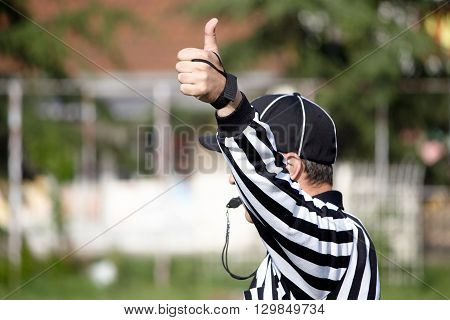 The back of an American football referee
