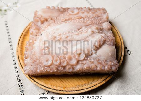 Frozen Octopus In A Wooden Plate
