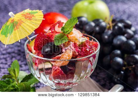 Sweet healthy fruit salad in a glass bowl
