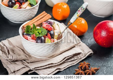 Diet, healthy fruit salad in the white bowl for breakfast, weight loss concept
