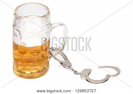 mug of beer with handcuffs over white