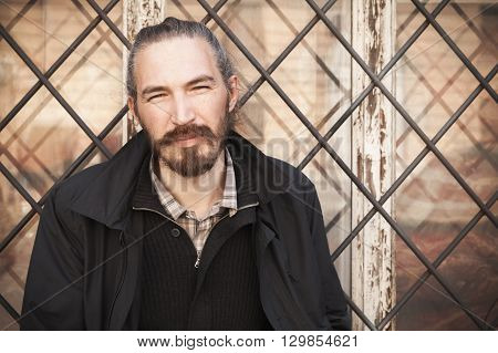 Asian Man In Black On Grungy Window Background