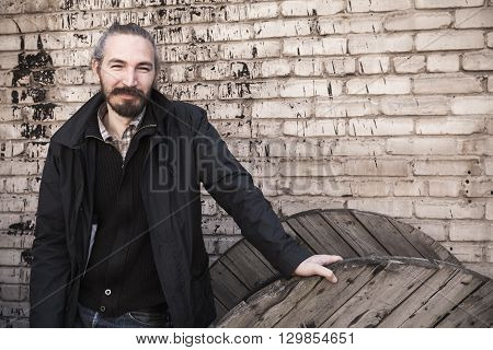 Outdoor Portrait Of Young Asian Man In Black