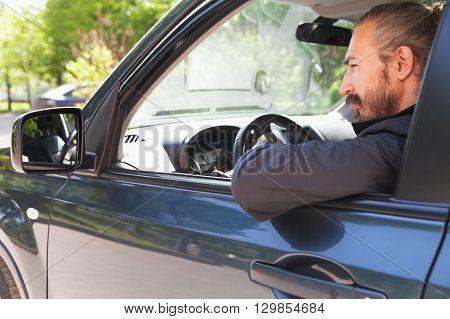 Driver Of Modern Suv Looks In Open Car Window