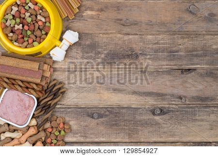 Dod food selection on wooden background with copy space, top view