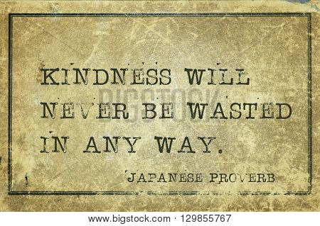 Kindness will never be wasted - ancient Japanese proverb printed on grunge vintage cardboard