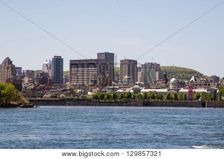 MONTREAL CANADA - 17TH MAY 2015: A view of downtown Montreal during the day showing buildings office and Montreal Port