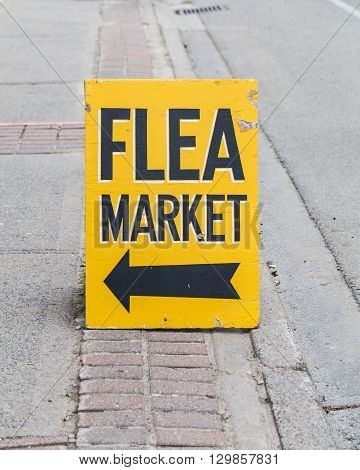 Sign and Arrow for a Flea Market on a street