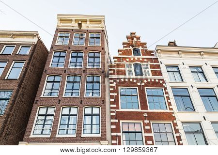 AMSTERDAM NETHERLANDS - 16TH FEBRUARY 2016: A closeup to typical houses in the Centrum area of Amsterdam during the day.