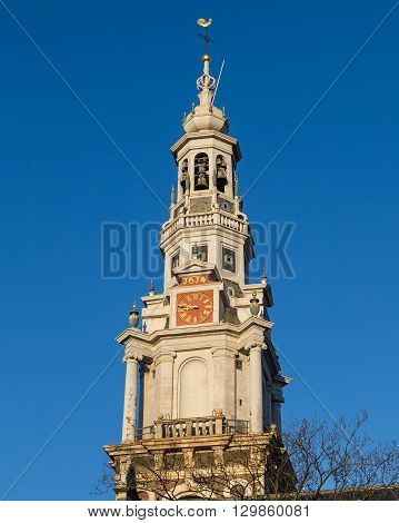 Closeup to the Clock Tower on Zuiderkerk Church in Amsterdam during the day.