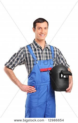A Worker Wearing A Overall And Holding A Welding Mask