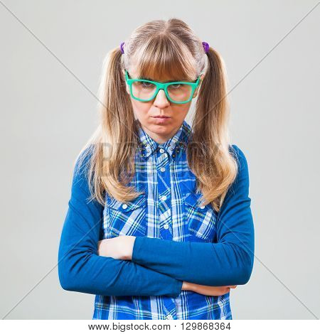 Studio shot portrait of angry nerdy woman