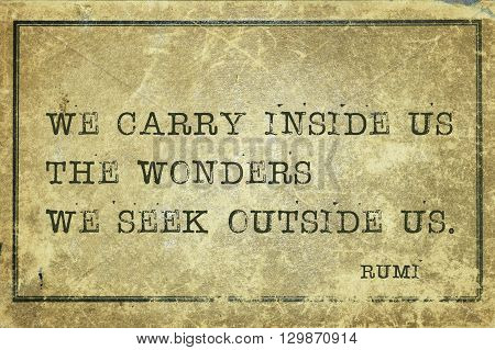 We carry inside us the wonders - ancient Persian poet and philosopher Rumi quote printed on grunge vintage cardboard