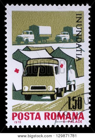 ZAGREB, CROATIA - JULY 18: a stamp printed in Romania shows Tent camp and ambulance of the Red Cross, Plight of the Danube flood victims, circa 1970, on July 18, 2012, Zagreb, Croatia