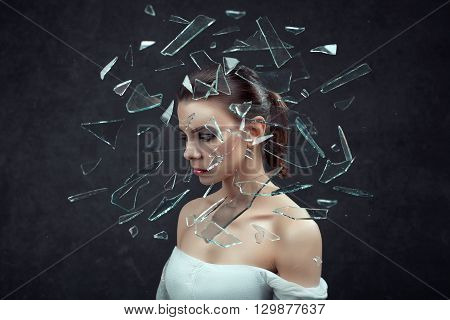 Stress woman stressed with headache. Female stressed and worried with migraine headache pain. Concept with young female model on dark background.