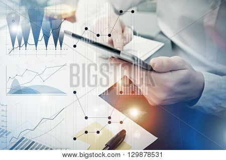 Banker manager working process.Photo analyst trader work market charts.Using electronic device.Graphic icons, worldwide online stock exchanges interfaces on screen.Business project startup.Film effect.