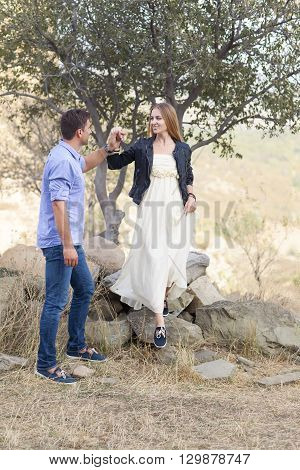 Beautiful happy smiling couple embracing outdoors near the tree