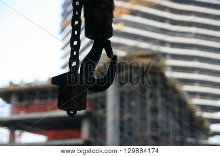 Crane hooks worksite construction tower crane transport support worker.