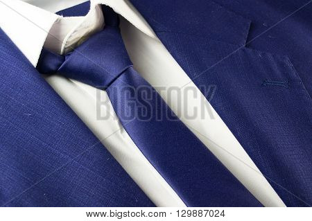 Detail view of business blue suit with tie