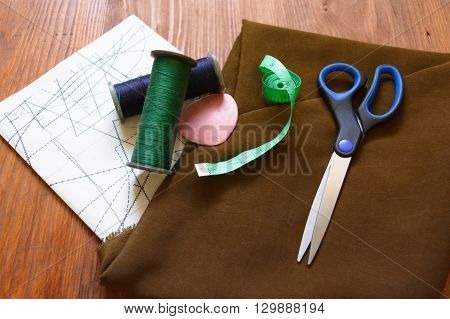 macro composition fabric for sewing sartorial meter measuring tape scissors chalk threads patterns schemes