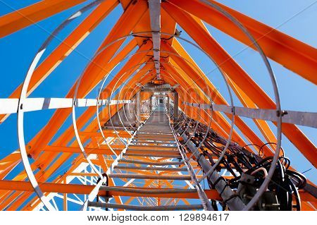 telecommunications tower, bottom view. look up under the tower of cellular communication poster